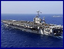 "A US aircraft carrier entered a zone near the Strait of Hormuz being used by the Iranian navy for wargames, an Iranian official said Thursday amid rising tensions over the key oil-transit channel. ""A US aircraft carrier was spotted inside the manoeuvre zone... by a navy reconnaissance aircraft,"" Commodore Mahmoud Mousavi, the spokesman for the Iranian exercises, told the official IRNA news agency."
