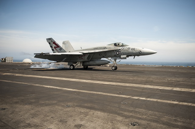 ATLANTIC OCEAN (April 20, 2015) An F/A-18E Super Hornet attached to Air Test and Evaluation Squadron (VX) 23 lands on the flight deck of the aircraft carrier USS George H.W. Bush (CVN 77). George H.W. Bush is conducting training exercises in the Atlantic Ocean. (U.S. Navy photo by Mass Communication Specialist Seaman Christopher D. Gaines/Released)